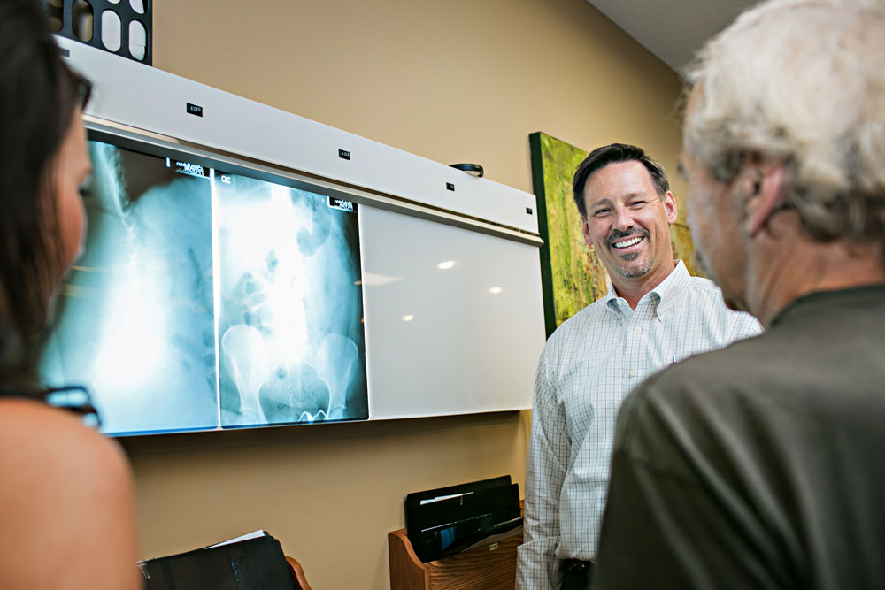 Dr. Harder looking at x-ray with patient